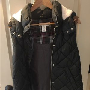 Dark green quilted winter vest from H&M